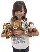 Girl holding cuddly toys
